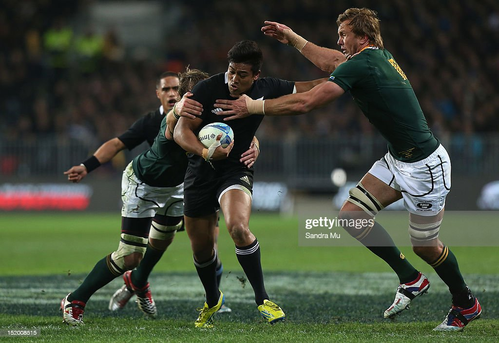 Julian Savea of the All Blacks fends off Andries Bekker of South Africa during the Rugby Championship match between the New Zealand All Blacks and...