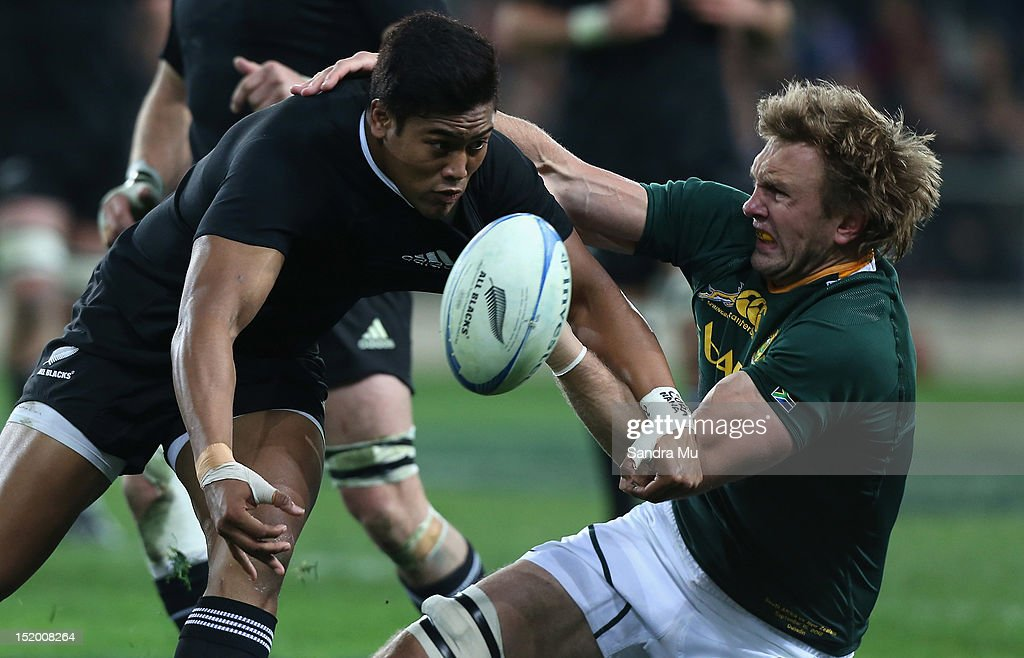 Julian Savea of the All Blacks is tackled by Andries Bekker of South Africa during the Rugby Championship match between the New Zealand All Blacks...