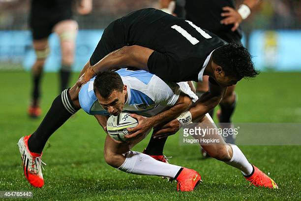 Julian Savea of the All Blacks tackles Juan Imhoff of Argentina during The Rugby Championship match between the New Zealand All Blacks and Argentina...