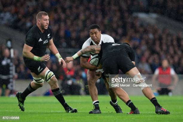 Julian Savea of the Barbarians is tackled by New Zealands Vaea Fifita during the Killik Cup match between Barbarians and New Zealand at Twickenham...