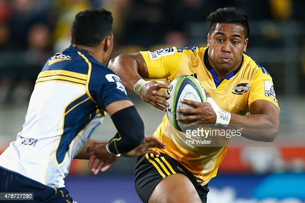 Julian Savea of the Hurricanes fends off Nigel Ah Wong of the Brumbies during the Super Rugby Semi Final match between the Hurricanes and the...