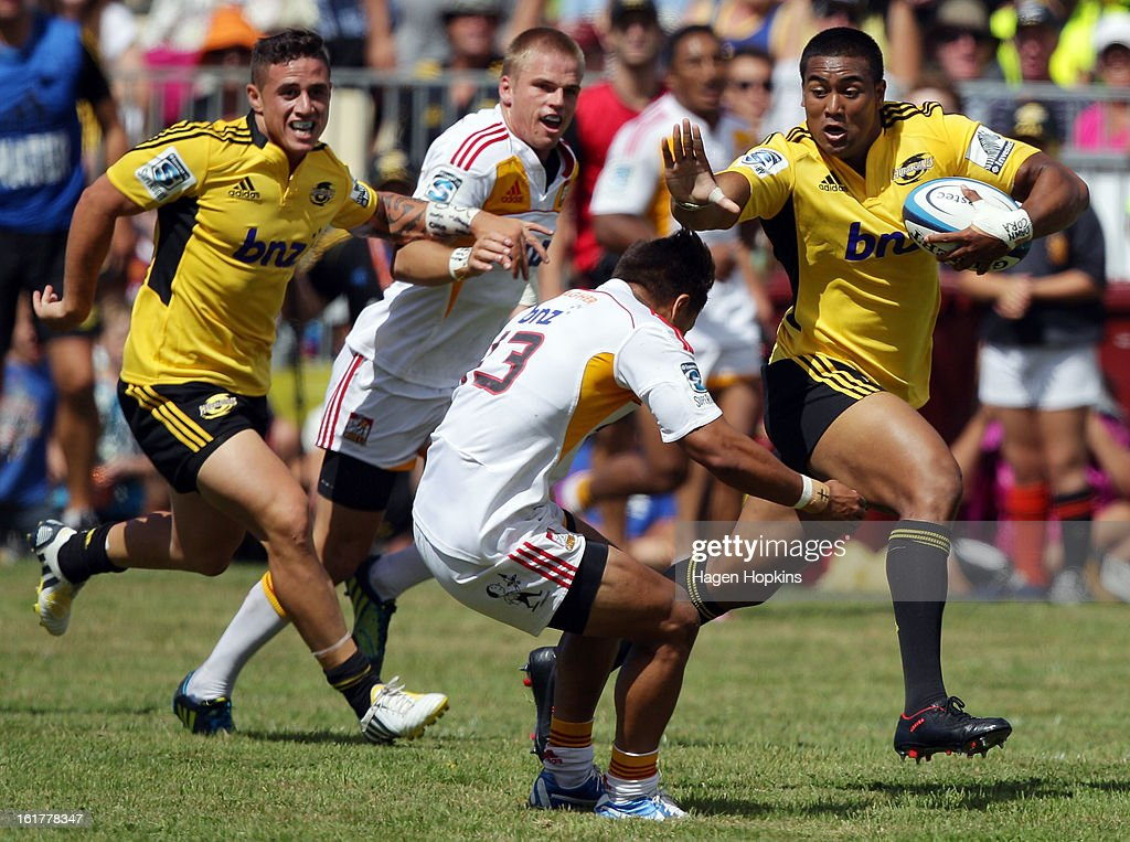 Julian Savea of the Hurricanes fends Tim Nanai-Williams of the Chiefs during the Super Rugby trial match between the Hurricanes and the Chiefs at Mangatainoka RFC on February 16, 2013 in Mangatainoka, New Zealand.