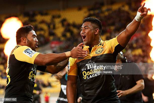 Julian Savea of the Hurricanes is congratulated on his try by teammate Vince Aso during the round seven Super Rugby match between the Hurricanes and...