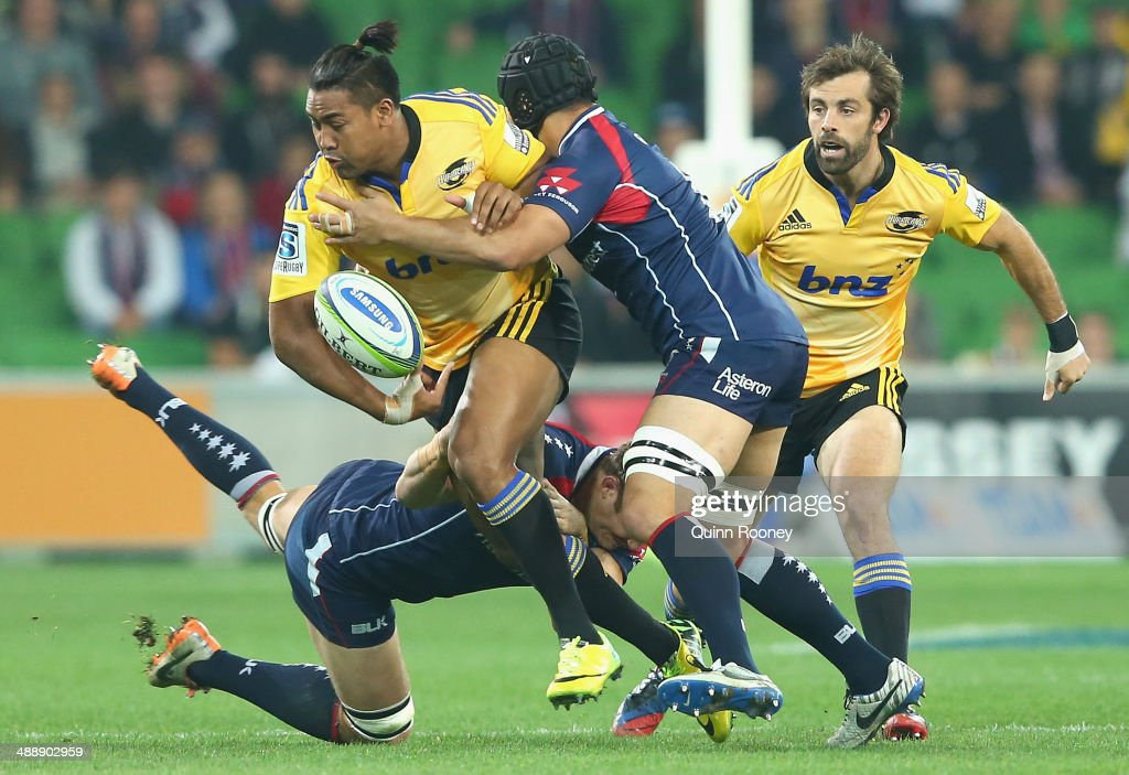 <a gi-track='captionPersonalityLinkClicked' href=/galleries/search?phrase=Julian+Savea&family=editorial&specificpeople=5780264 ng-click='$event.stopPropagation()'>Julian Savea</a> of the Hurricanes is tackled by <a gi-track='captionPersonalityLinkClicked' href=/galleries/search?phrase=Scott+Higginbotham&family=editorial&specificpeople=2303432 ng-click='$event.stopPropagation()'>Scott Higginbotham</a> of the Rebels during the round 13 Super Rugby match between the Rebels and the Hurricanes at AAMI Park on May 9, 2014 in Melbourne, Australia.