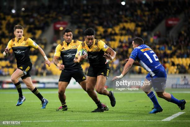 Julian Savea of the Hurricanes makes a break on his way to scoring a try during the round 11 Super Rugby match between the Hurricanes and the...