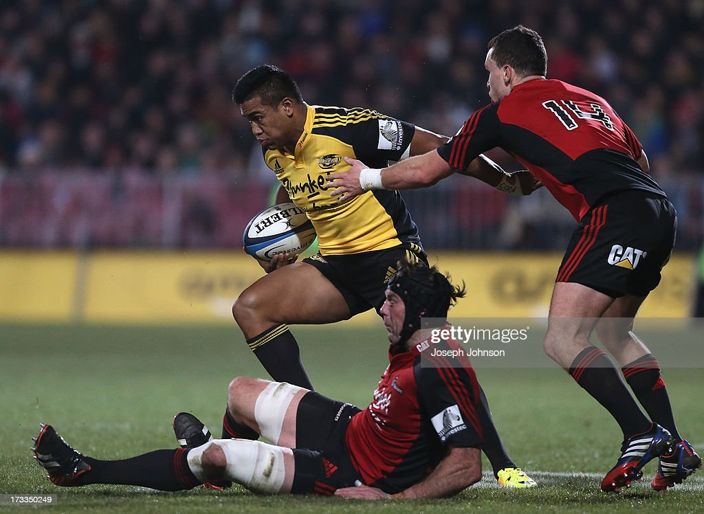 <a gi-track='captionPersonalityLinkClicked' href=/galleries/search?phrase=Julian+Savea&family=editorial&specificpeople=5780264 ng-click='$event.stopPropagation()'>Julian Savea</a> of the Hurricanes runs with the ball in the tackle of Tom Donnelly and Tom Marshall of the Crusaders during the round 20 Super Rugby match between the Crusaders and the Hurricanes at AMI Stadium on July 12, 2013 in Christchurch, New Zealand.