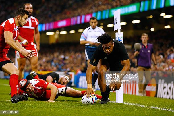 Julian Savea of the New Zealand All Blacks goes over to score their second try during the 2015 Rugby World Cup Pool C match between New Zealand and...