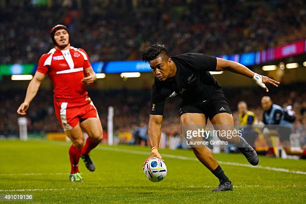 Julian Savea of the New Zealand All Blacks goes over to score their third try during the 2015 Rugby World Cup Pool C match between New Zealand and...
