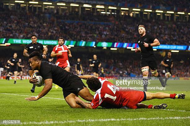 Julian Savea of the New Zealand All Blacks scores his team's sixth try and completes his hat trick as Giorgi Aptsiauri of Georgia challenges during...