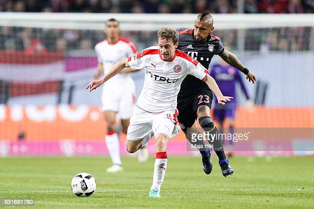 Julian Schauerte of Duesseldorf and Arturo Vidal of Bayern fight for the ball during the Telekom Cup 2017 match between Fortuna Duesseldorf and...
