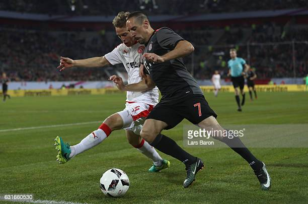 Julian Schauerte of Duesseldorf challenges Franck Ribery of Muenchen during the Telekom Cup 2017 match between Fortuna Duesseldorf and Bayern...