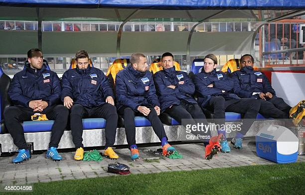 Julian Schieber Marvin Plattenhardt John Heitinga Sandro Wagner Peter Niemeyer and Ronny of Hertha BSC sit on the bench during the DFB Cup match...
