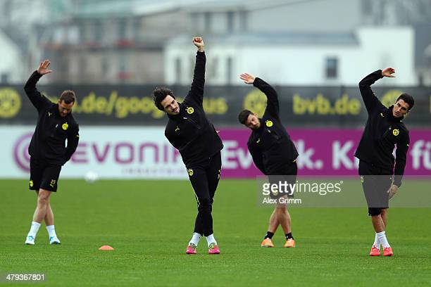Julian Schieber Mats Hummels Milos Jojic and Nuri Sahin exercise during a Borussia Dortmund training session ahead of their UEFA Chamions League...