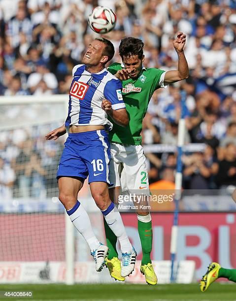 Julian Schieber of Berlin and Santiago Garcia of Bremen jump for a header during the Bundesliga match between Hertha BSC and SV Werder Bremen at...