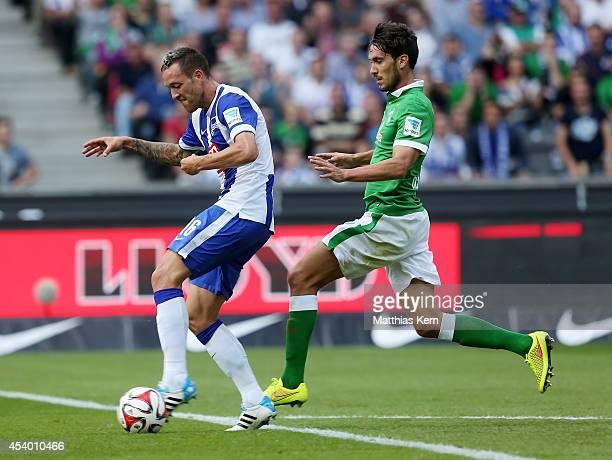 Julian Schieber of Berlin battles for the ball with Santiago Garcia of Bremen during the Bundesliga match between Hertha BSC and SV Werder Bremen at...