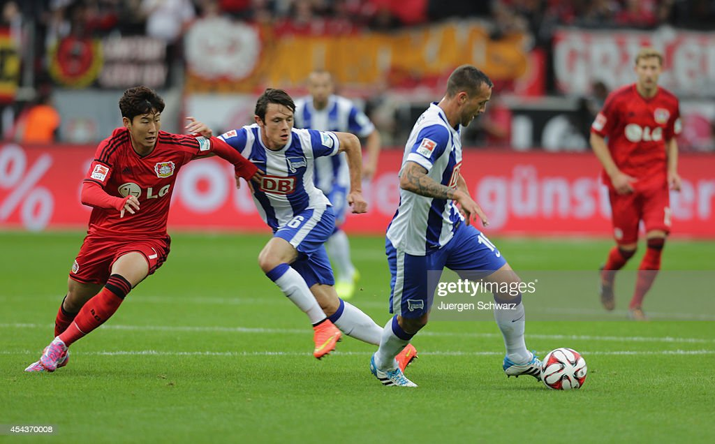 Julian Schieber of Berlin (R) controls the ball near Nico Schulz (C) and Heung-Min Son of Leverkusen during the Bundesliga match between Bayer Leverkusen and Hertha BSC Berlin at BayArena on August 30, 2014 in Leverkusen, Germany.