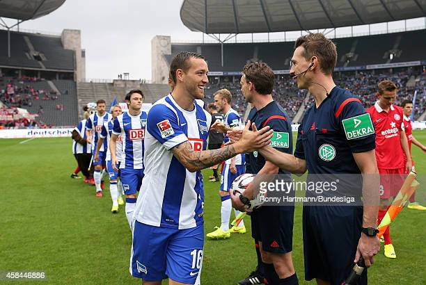 Julian Schieber of Berlin shake hands with assistant referee Christian Bandurski prior to the Bundesliga match between Hertha BSC and FSV Mainz 05 at...