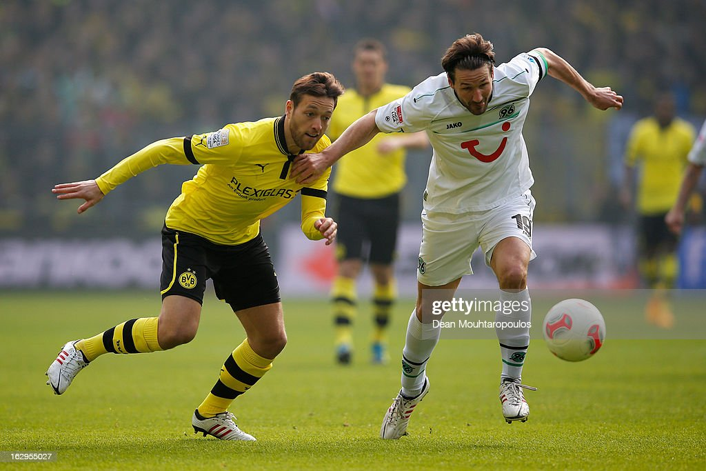 <a gi-track='captionPersonalityLinkClicked' href=/galleries/search?phrase=Julian+Schieber&family=editorial&specificpeople=4272399 ng-click='$event.stopPropagation()'>Julian Schieber</a> of Dortmund and <a gi-track='captionPersonalityLinkClicked' href=/galleries/search?phrase=Christian+Schulz&family=editorial&specificpeople=228730 ng-click='$event.stopPropagation()'>Christian Schulz</a> of Hannover battle for the ball during the Bundesliga match between Borussia Dortmund and Hannover 96 at Signal Iduna Park on March 2, 2013 in Dortmund, Germany.