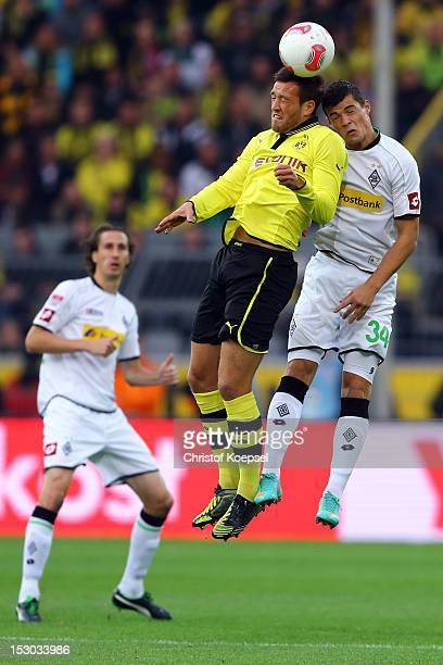 Julian Schieber of Dortmund and Granit Xhaka of Moenchengladbach go up for a header during the Bundesliga match between Borussia Dortmund and VfL...