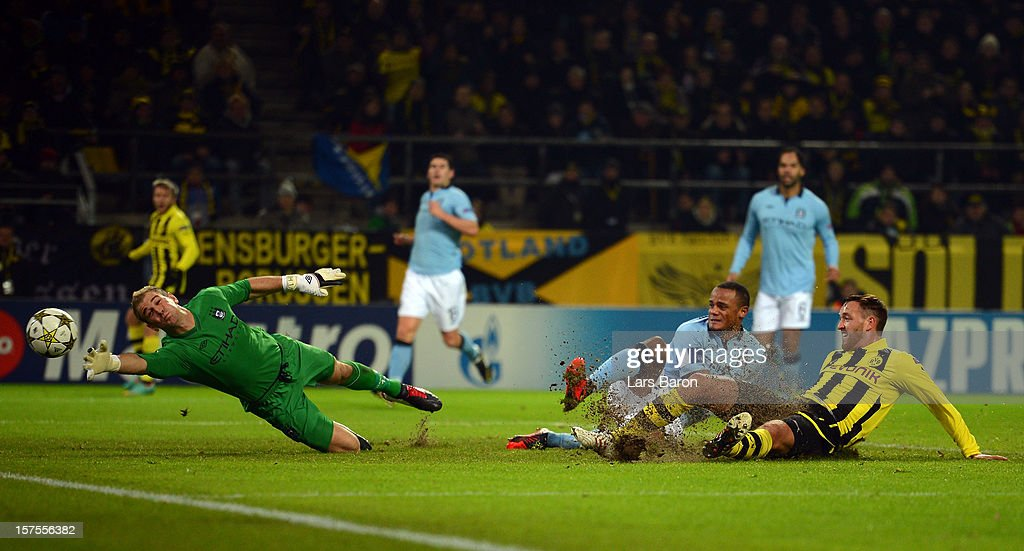 <a gi-track='captionPersonalityLinkClicked' href=/galleries/search?phrase=Julian+Schieber&family=editorial&specificpeople=4272399 ng-click='$event.stopPropagation()'>Julian Schieber</a> of Dortmund scores his teams first goal against goalkeeper Joe Hart and Vincent Kompany of Manchester during the UEFA Champions League group D match between Borussia Dortmund and Manchester City at Signal Iduna Park on December 4, 2012 in Dortmund, Germany.