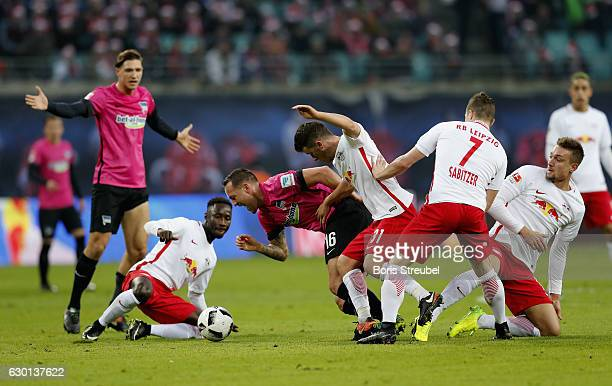 Julian Schieber of Hertha BSC is challenged by players of RB Leipzig during the Bundesliga match between RB Leipzig and Hertha BSC at Red Bull Arena...