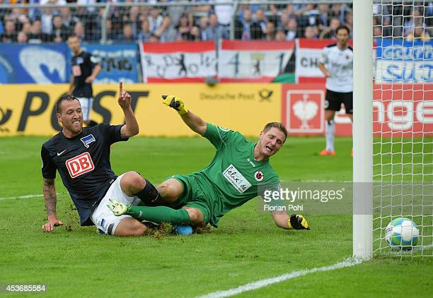 Julian Schieber of Hertha BSC scores their fourth goal past goalkeeper NicoStephano Pellatz of FC Viktoria Koeln during the cup match between FC...