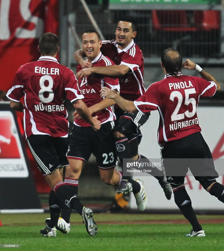 Julian Schieber of Nuernberg celebrates his goal with teammates Christian Eigler Ilkay Guendogan and Javier Pinola during the Bundesliga first league...
