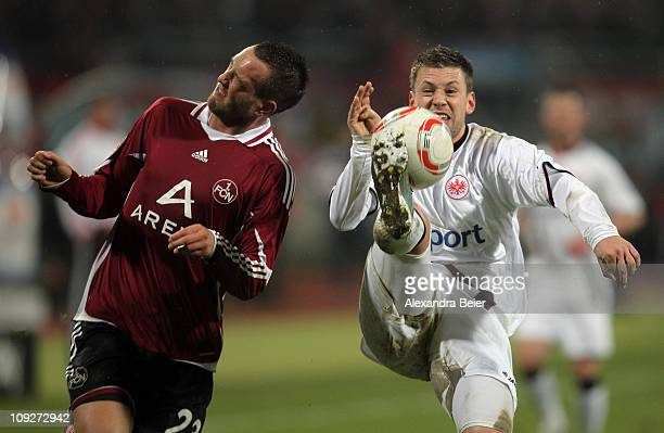 Julian Schieber of Nuernberg fights for the ball with Marco Russ of Frankfurt during the German Bundesliga match between 1 FC Nuernberg and Eintracht...