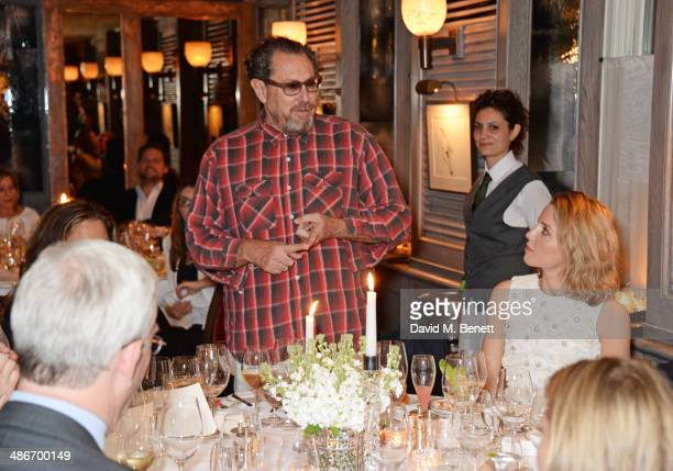 Julian Schnabel speaks as guests including Annabelle Wallis listen at an exclusive dinner hosted by Charles Finch Mulberry and PORTER Magazine for...