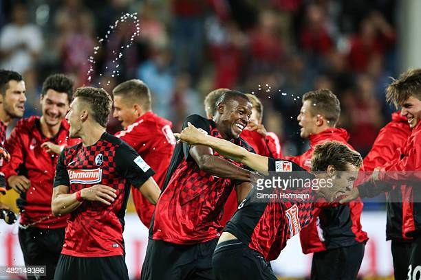 Julian Schuster and Karim Guede of Freiburg celebrate winning with team mates after the 2 Bundesliga match between SC Freiburg and 1 FC Nuernberg at...