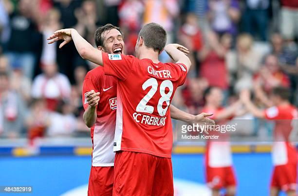 Julian Schuster L and Matthias Ginter of Freiburg celebrate after the Bundesliga match between SC Freiburg and Eintracht Braunschweig at Mage Solar...