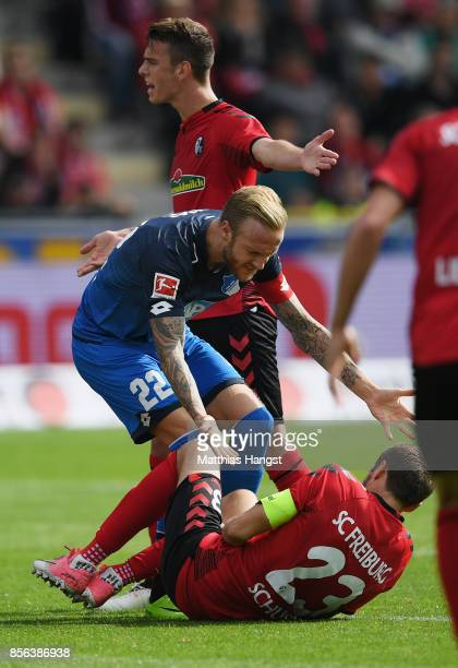 Julian Schuster of Freiburg breaks down after a clash with Kevin Vogt of Hoffenheim during the Bundesliga match between SportClub Freiburg and TSG...