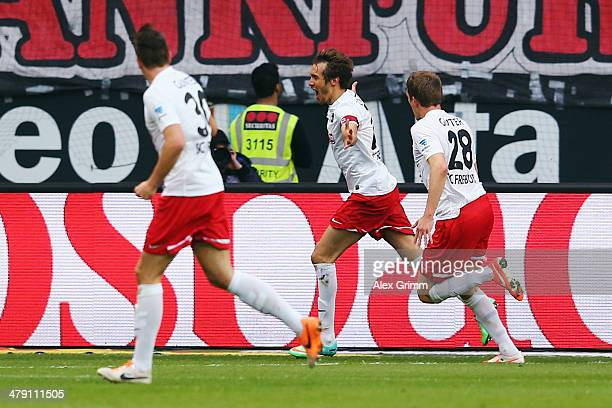 Julian Schuster of Freiburg celebrates his team's first goal with team mates Christian Guenter and Matthias Ginter during the Bundesliga match...