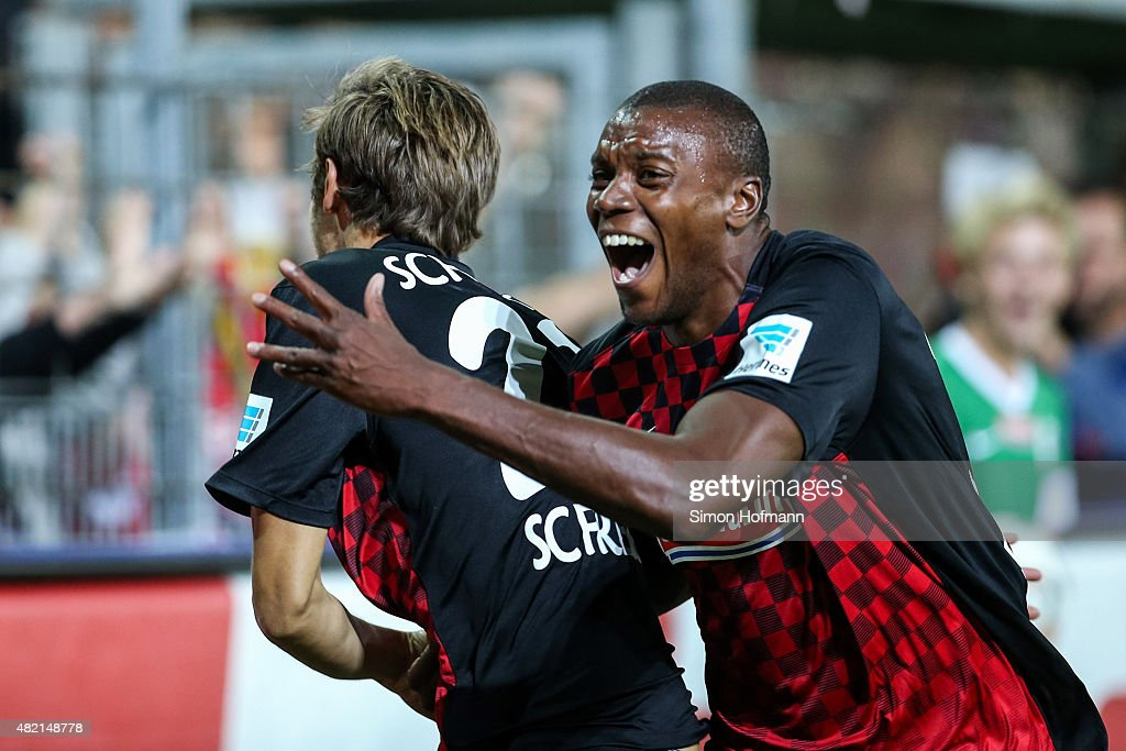 <a gi-track='captionPersonalityLinkClicked' href=/galleries/search?phrase=Julian+Schuster&family=editorial&specificpeople=2327389 ng-click='$event.stopPropagation()'>Julian Schuster</a> of Freiburg celebrates his team's sixth goal with team mate Karim Guede (R) during the 2. Bundesliga match between SC Freiburg and 1. FC Nuernberg at Schwarzwald-Stadion on July 27, 2015 in Freiburg im Breisgau, Germany.