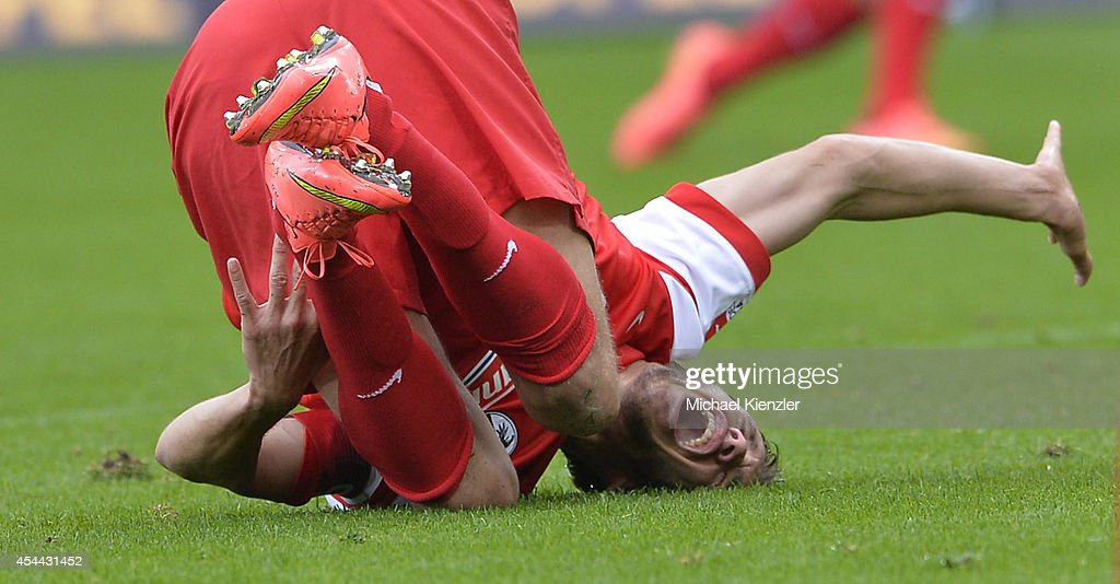 <a gi-track='captionPersonalityLinkClicked' href=/galleries/search?phrase=Julian+Schuster&family=editorial&specificpeople=2327389 ng-click='$event.stopPropagation()'>Julian Schuster</a> of Freiburg lays injured on pitch during the Bundesliga match between SC Freiburg and Borussia Moenchengladbach at Mage Solar Stadium on August 31, 2014 in Freiburg, Germany.