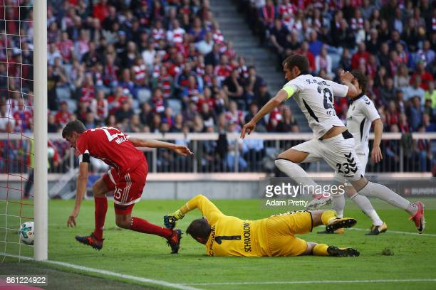 Julian Schuster of Freiburg scores an own goal to make it 10 for Munich while Thomas Mueller of Bayern Muenchen looks on during the Bundesliga match...