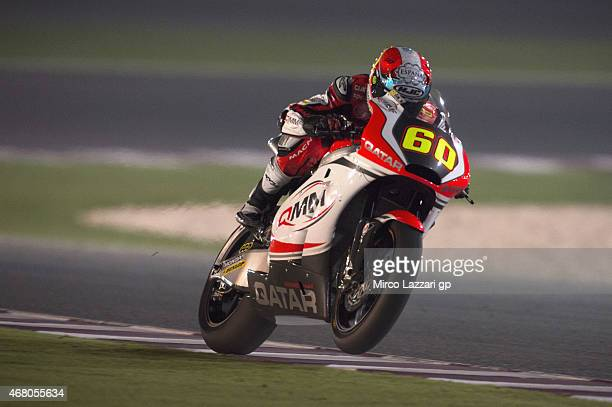 Julian Simon of Spain and Italtrans Racing Team heads down a straight during the Moto2 race during the MotoGp of Qatar Race at Losail Circuit on...