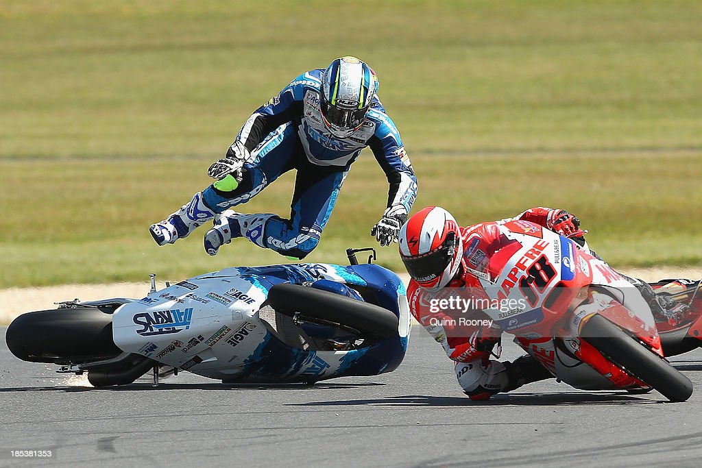 Julian Simon of Spain crashes his #60 Italtrans Racing Team Kalex during the Moto2 race at the Australian MotoG at Phillip Island Grand Prix Circuit on October 20, 2013 in Phillip Island, Australia.