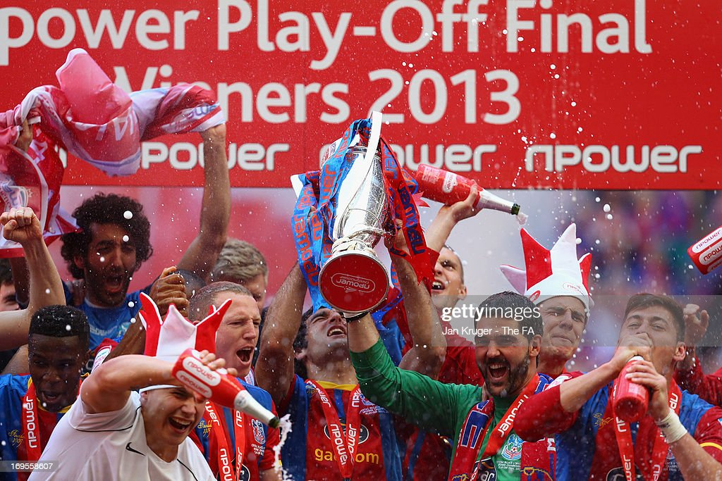 Julian Speroni of Crystal Palace and his team-mates celebrate with the trophy following their victory in extra-time during the npower Championship Play-off Final match between Watford and Crystal Palace at Wembley Stadium on May 27, 2013 in London, England.
