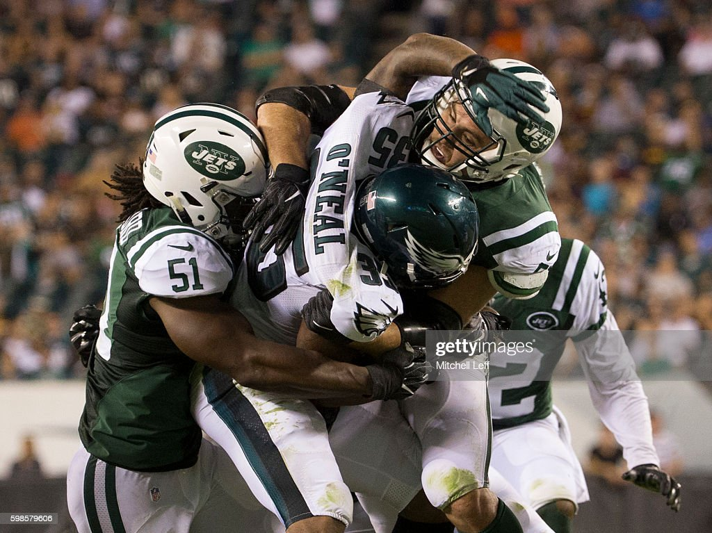 Julian Stanford #51 and Trevor Reilly #57 of the New York Jets tackle Cedric O'Neal #35 of the Philadelphia Eagles in the fourth quarter at Lincoln Financial Field on September 1, 2016 in Philadelphia, Pennsylvania. The Eagles defeated the Jets 14-6.