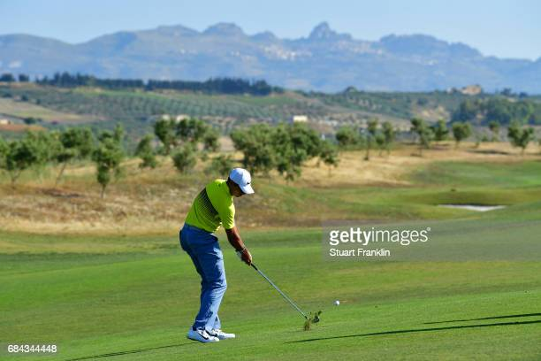 Julian Suri of the United States hits an approach during the first round of the Rocco Forte Open at Verdura Golf and Spa Resort on May 18 2017 in...