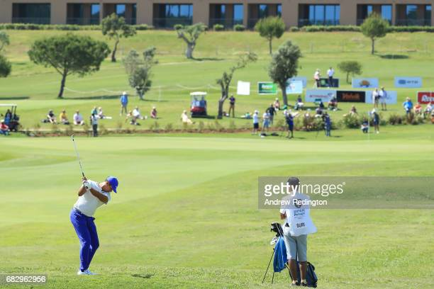 Julian Suri of the United States plays his second shot on the 18th hole during the final round on day four of the Open de Portugal at Morgado Golf...
