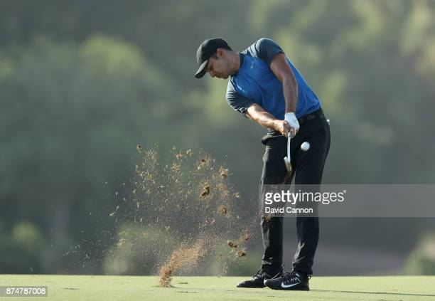 Julian Suri of the United States plays his second shot on the third hole during the first round of the DP World Tour Championship on the Earth Course...