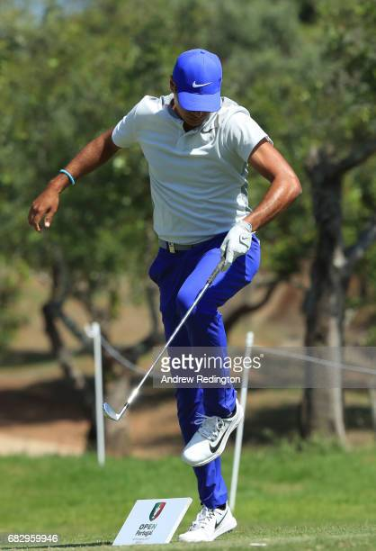 Julian Suri of the United States trips over a tee marker on the 16th hole during the final round on day four of the Open de Portugal at Morgado Golf...