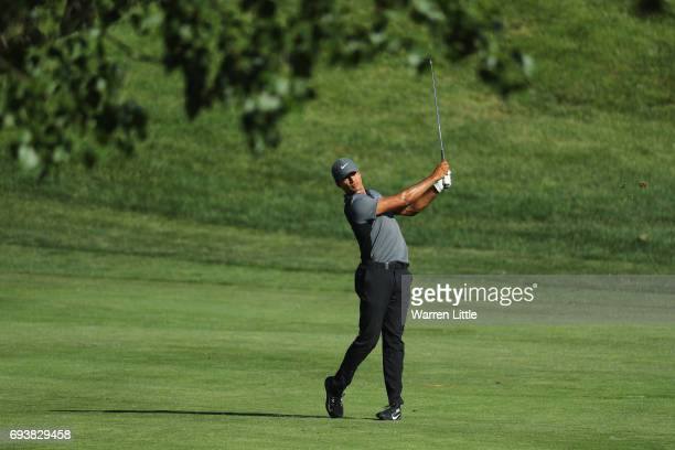 Julian Suri of the USA plays his second shot into the eighth green during the first round of the Lyoness Open at Diamond Country Club on June 8 2017...