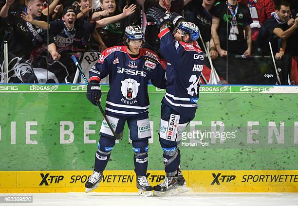 Julian Talbot and Andre Rankel of the Eisbaeren Berlin celebrate after scoring the 64 during the game between Eisbaeren Berlin and Augsburger Panther...