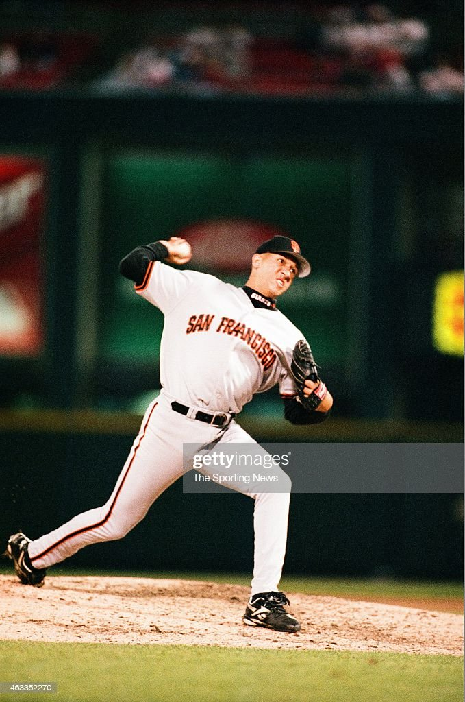 Julian Tavarez of the San Francisco Giants pitches against the St. Louis Cardinals at Busch Stadium on April 29, 1997 in St. Louis, Missouri.
