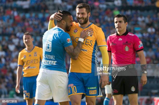 Julian Velazquez of Cruz Azul and AndrePierre Gignac of Tigres embrace during the 11th round match between Cruz Azul and Tigres UANL as part of the...