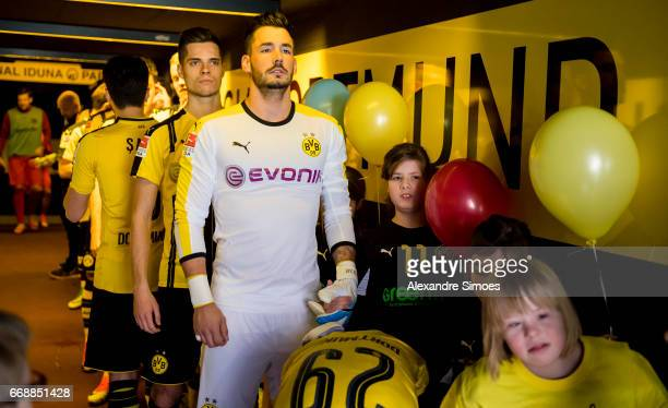 Julian Weigl and goal keeper Roman Buerki of Borussia Dortmund on their way to the field prior to the Bundesliga match between Borussia Dortmund and...