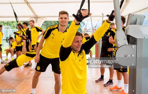 Julian Weigl and goalkeeper Roman Weidenfeller of Borussia Dortmund in action during a training session as part of the training camp on July 29 2017...
